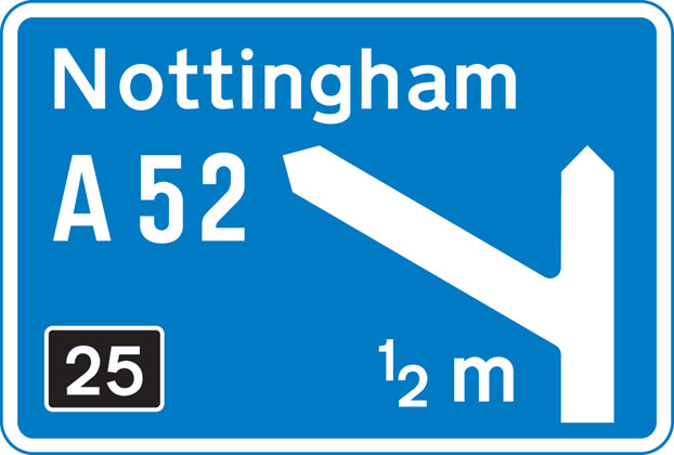 direction sign blue approach to junction